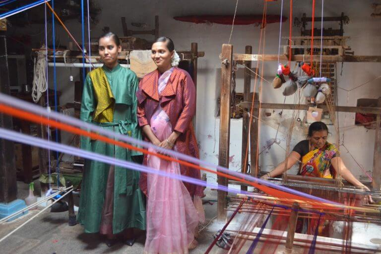 Weavers-shocasing-posing-in-Vaishali-Ss-sustainable-designer-garments